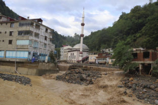 The road has been swept away and debris strewn across the area after floods caused by heavy rain in the mountain town of Dereli in Giresun province, along Turkey's Black Sea coastline, Sunday, Aug. 23, 2020. Interior Minister Suleyman Soylu said four people have died and 11 people are still missing after flooding around Dereli.(AP Photo)