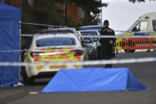A police officer and vehicles are seen at a cordon in Irving Street in Birmingham after a number of people were stabbed in the city centre, Sunday, Sept. 6, 2020. British police say that multiple people have been injured in a series of stabbings in a busy nightlife area of the central England city of Birmingham.