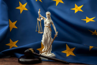 European union court of justice or ECJ, legal system in Europe and the legislature branch of government concept with a gavel, a statue of Themis the lady of justice and the EU flag