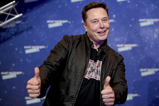 SpaceX owner and Tesla CEO Elon Musk arrives on the red carpet for the Axel Springer media award, in Berlin, Germany, Tuesday, Dec. 1, 2020. ()