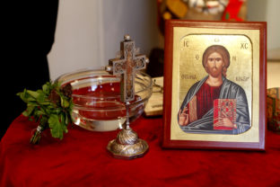 Holy water, painted picture of Crist and a cross