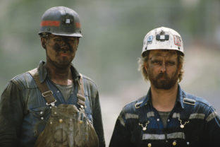 Portrait of two soiled hard working caucasian coal miners