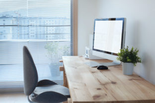 Workspace interior with computer on wooden table and office chair