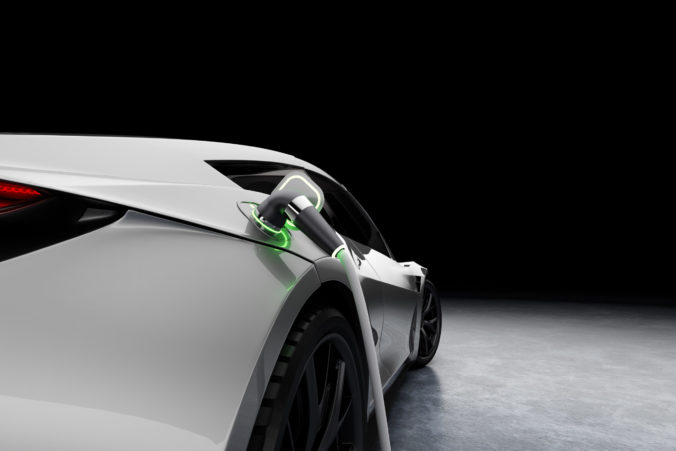 E Mobility and ecology. Charging an electric sports car with black background. Charging battery concept. 3D rendering.