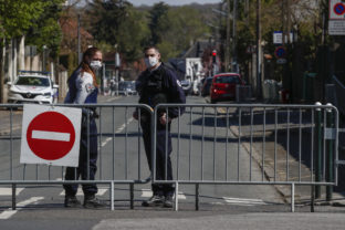 French police officers block the access next to the police station where a police official was stabbed to death Friday in Rambouillet, south west of Paris, Saturday, April 24, 2021. Anti-terrorism Investigators were questioning three people Saturday detained after the deadly knife attack a day earlier on a police official at the entry to her station in the quiet town of Rambouillet, seeking a motive, purported ties to a terrorist group and whether the attacker, killed by police, acted alone. ()