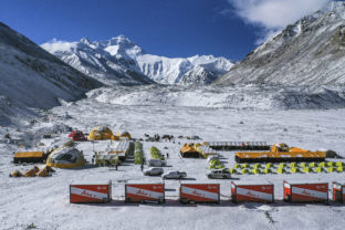 FILE - In this April 30, 2020, aerial file photo released by China's Xinhua News Agency, vehicles and tents are seen at the base camp at the foot of the Chinese side of the peak of Mount Qomolangma, also known as Mount Everest, in southwestern China's Tibet Autonomous Region. China has canceled attempts to climb Mount Everest from its side of the world's highest peak because of fears of importing COVID-19 cases from neighboring Nepal, state media reported. (