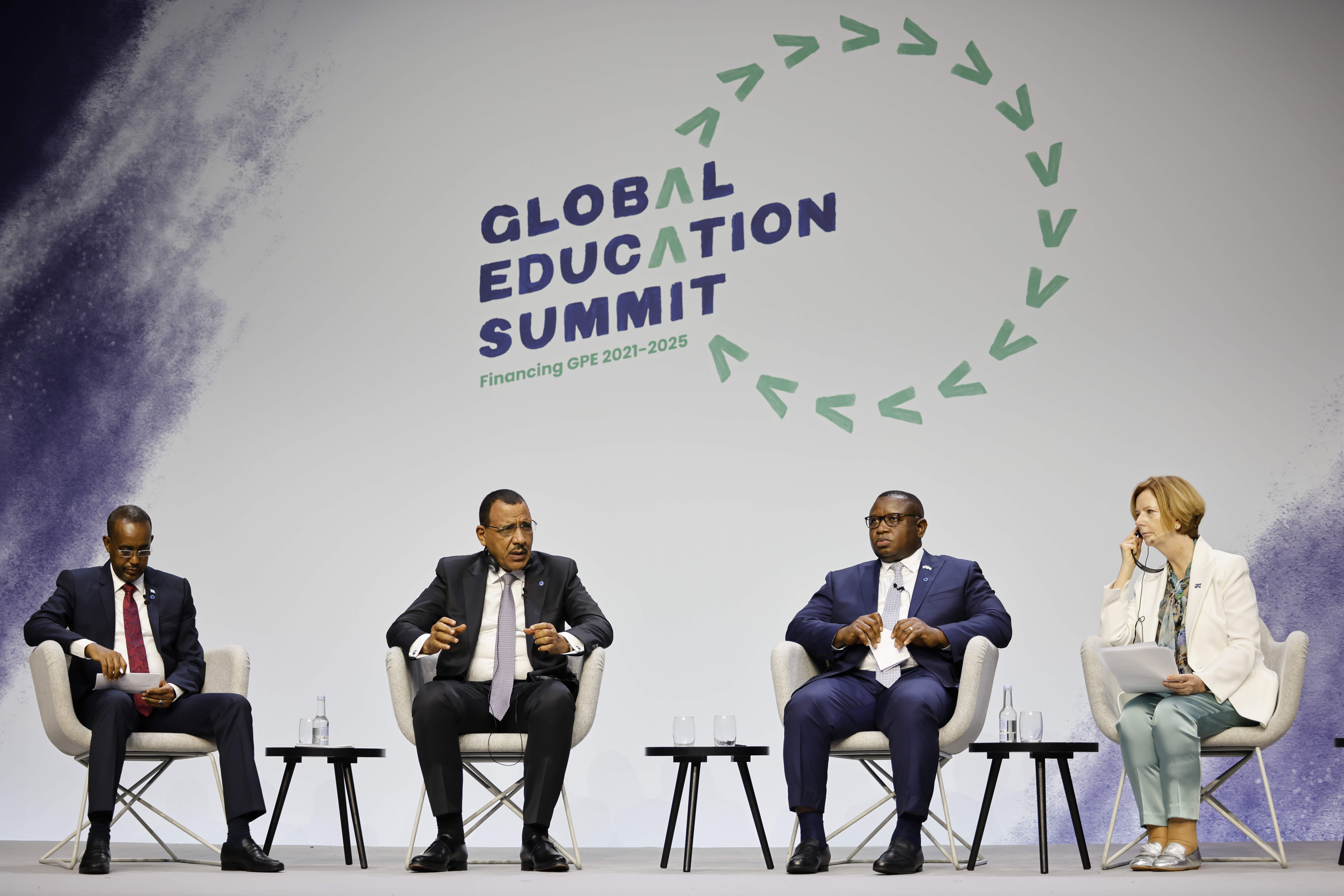 """From left, Somalia's Prime Minister Mohamed Hussein, Niger's President Mohamed Bazoum and Sierra Leone's President Julius Maada Bio take part in a session entitled """"The Power of Education"""" on the second day of the Global Education Summit in London, Thursday, July 29, 2021 hosted by Australia's former prime minister Julia Gillard, right."""