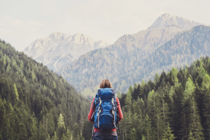 Young woman traveler in a mountains