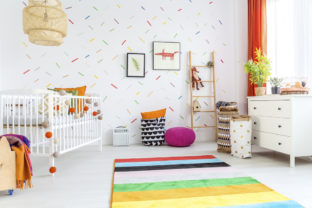 White,Baby,Room,With,Cot,And,Colorful,Rug