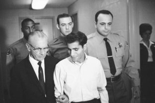 FILE - In this June 28, 1968, file photo, Sirhan Bishara Sirhan is escorted by his attorney, Russell E. Parsons from Los Angeles county jail chapel to enter plea to charge of murder in Los Angeles. U.S. Sen. Robert F. Kennedy's assassin was granted parole Friday, Aug. 27, 2021, after two of RFK's sons spoke in favor of Sirhan Sirhan's release and prosecutors declined to argue he should be kept behind bars. ()