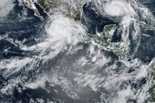 This image provided by the National Oceanic and Atmospheric Administration (NOAA) shows severe weather systems, Hurricane Nora, upper left, and Hurricane Ida, upper right, over the North American continent on Saturday, Aug. 28, 2021. Hurricane Nora is churning northward up Mexico's Pacific Coast toward the narrow Gulf of California, after making a sweep past the Puerto Vallarta area.