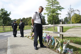 """Britain Woman Killed Chief Superintendent Trevor Lawry stands by the floral tributes at Cator Park in Kidbrooke, near to the area where the body of Sabina Nessa was found, in London, Thursday, Sept. 23, 2021. British police investigating the killing of a 28 year old woman in London say they are probing whether she was attacked by a stranger. It's a case that sparked new concerns for the safety of women walking the capital's streets. Police called for information over the murder of a primary school teacher Sabina Nessa on Sept.17 in southeast London. Detectives believe she was attacked during what would have been a five minute walk through a local park on her way to meet a friend at the pub. The case came just a few months after the abduction, rape and murder of 33 year old Sarah Everard in south London by a serving police officer. London Mayor Sadiq Khan described the violence against women as a national """"epidemic."""" ()"""