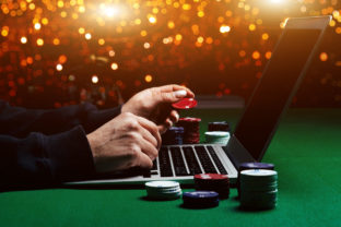 Person playing online poker and looking winning cards. Concept win and lose in casino.