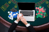 Casino, online gambling, technology and people concept - close up