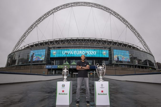 92026_henry with euro and ucl trophy with wembley arch backdrop 2 676x451.jpg