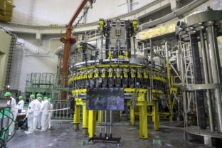 FILE - In this Friday, Aug. 7, 2020 file photo, personnel work to begin loading nuclear fuel at Belarus' first nuclear plant which was built by Russia's state nuclear corporation Rosatom, near Astravets, Belarus. Belarus' first nuclear power plant has started operating, a project that has spooked its neighbor Lithuania. The Russia-built Astravyets nuclear power plant, 40 kilometers (25 miles) south of the Lithuanian capital Vilnius began generating electricity on Tuesday, Nov. 3, 2020 according to the Belarusian electricity operator Belenergo. Lithuanian authorities long have opposed the plant's construction, arguing that the project has been plagued by accidents, stolen materials and mistreatment of workers.