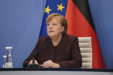 German Chancellor Angela Merkel speaks at the Chancellery in Berlin, Germany, Tuesday, Jan. 26, 2021 during an online conference at the Davos Agenda. The Davos Agenda from Jan. 25 to Jan. 29, 2021 is an online edition due to the coronavirus disease (COVID-19) outbreak. The global effort in the fight against the coronavirus pandemic is among the major topics facing the Davos forum this year.