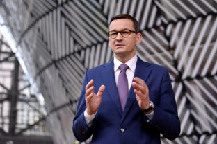 Poland's Prime Minister Mateusz Morawiecki arrives for an EU summit at the European Council building in Brussels, Thursday, Dec. 10, 2020. European Union leaders meet for a year-end summit that will address anything from climate, sanctions against Turkey to budget and virus recovery plans. Brexit will be discussed on the sidelines. (
