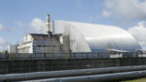 A shelter construction covers the exploded reactor at the Chernobyl nuclear plant, in Chernobyl,Ukraine, Tuesday, April 27, 2021. The Ukrainian authorities decided to use the deserted exclusion zone around the Chernobyl power plant to build a repository where Ukraine could store its nuclear waste for the next 100 years. (
