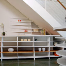 Stylish and chic shelves beneath the stairs.jpg