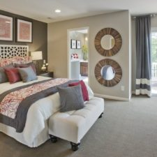 Contemporary master bedroom with artwork accent wall and throw pillows i_g ispl5c60t9clry0000000000 cmeho.jpg