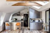 Attic kitchen with skylights and tiled backsplash.jpg
