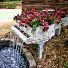 Old piano turned into outdoor water fountain.jpg