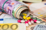 Pharmaceutical business. euro banknotes with pills.